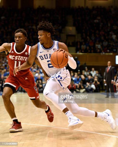 Cam Reddish of the Duke Blue Devils drives against Markell Johnson of the North Carolina State Wolfpack at Cameron Indoor Stadium on February 16 2019...