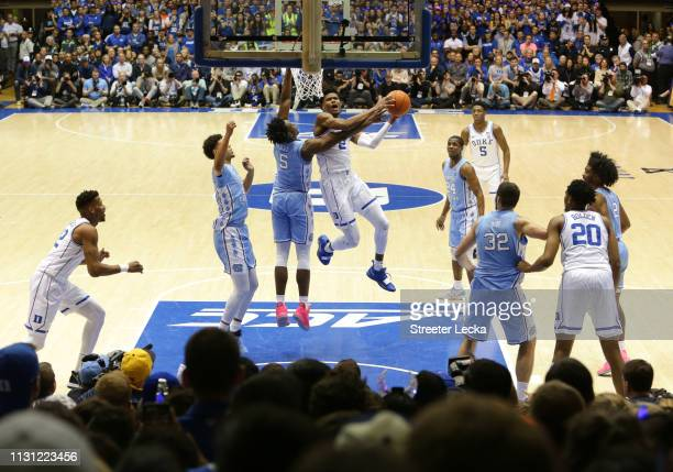 Cam Reddish of the Duke Blue Devils drives to the basket against Nassir Little of the North Carolina Tar Heels during their game at Cameron Indoor...