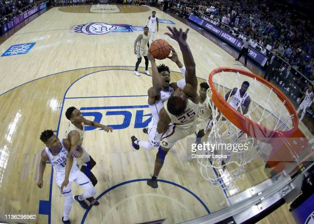 Cam Reddish of the Duke Blue Devils drives to the basket against Mfiondu Kabengele of the Florida State Seminoles during the championship game of the...