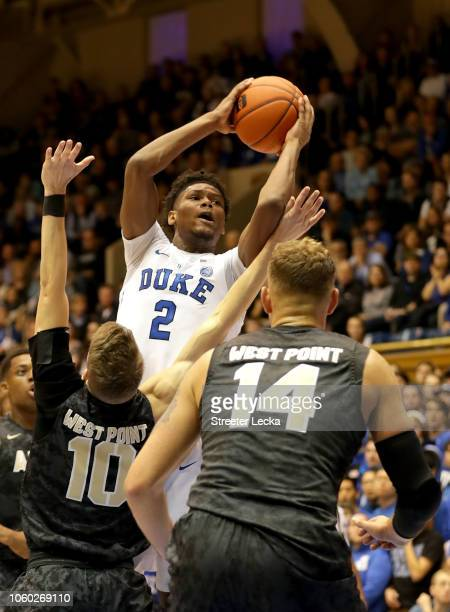 Cam Reddish of the Duke Blue Devils drives to the basket against teammates Jacob Kessler and Matt Wilson of the Army Black Knights during their game...