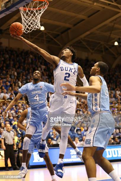 Cam Reddish of the Duke Blue Devils drives to the basket against teammates Brandon Robinson and Garrison Brooks of the North Carolina Tar Heels...
