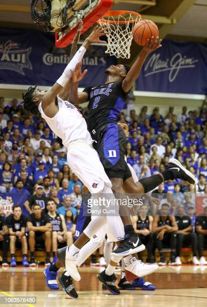 Cam Reddish of the Duke Blue Devils is fouled by Jalen McDaniels of the San Diego State Aztecs as he shoots during the second half of the game at...