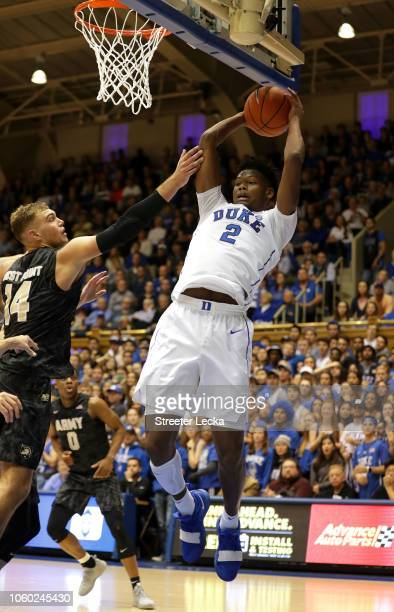 Cam Reddish of the Duke Blue Devils looks to pass around Matt Wilson of the Army Black Knights during their game at Cameron Indoor Stadium on...