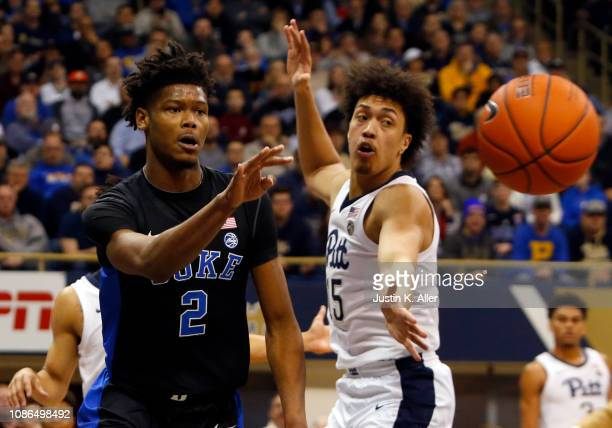 Cam Reddish of the Duke Blue Devils passes against Kene Chukwuka of the Pittsburgh Panthers at Petersen Events Center on January 22 2019 in...
