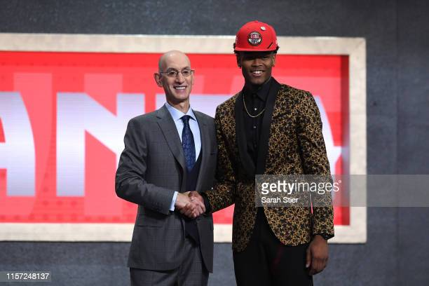 Cam Reddish poses with NBA Commissioner Adam Silver after being drafted with the tenth overall pick by the Atlanta Hawks during the 2019 NBA Draft at...