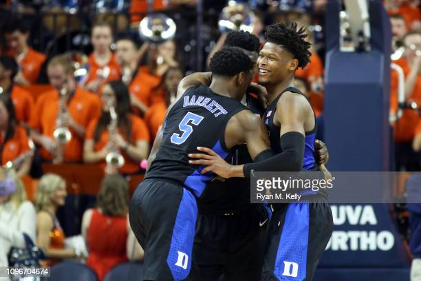 Cam Reddish RJ Barrett and Zion Williamson of the Duke Blue Devils hug in the second half during a game against the Virginia Cavaliers at John Paul...