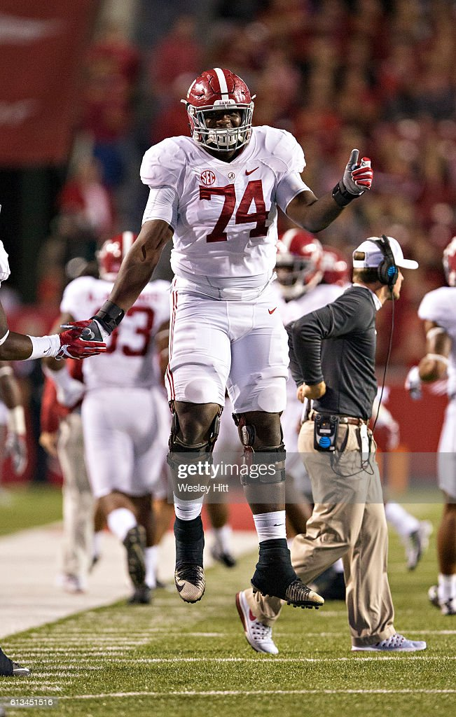 Cam Robinson #74 of the Alabama Crimson Tide jumps for joy after a touchdown during a game against the Arkansas Razorbacks at Razorback Stadium on October 8, 2016 in Fayetteville, Arkansas. The Crimson Tide defeated the Razorbacks 49-30.