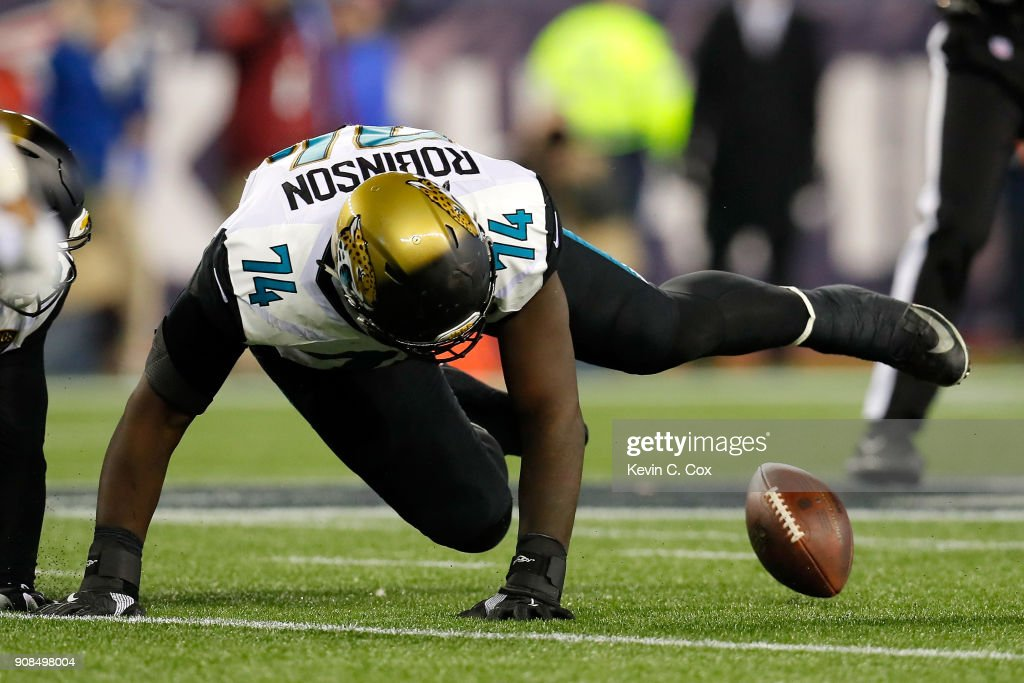 Cam Robinson #74 of the Jacksonville Jaguars attempts to recover a fumble in the second half against the New England Patriots during the AFC Championship Game at Gillette Stadium on January 21, 2018 in Foxborough, Massachusetts.