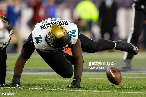 Cam Robinson of the Jacksonville Jaguars attempts to recover a fumble in the second half against the New England Patriots during the AFC Championship...