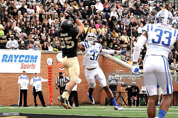 Cam Serigne of the Wake Forest Demon Deacons catches a pass for a 10yard touchdown against Phillip Carter of the Duke Blue Devils at BBT Field on...