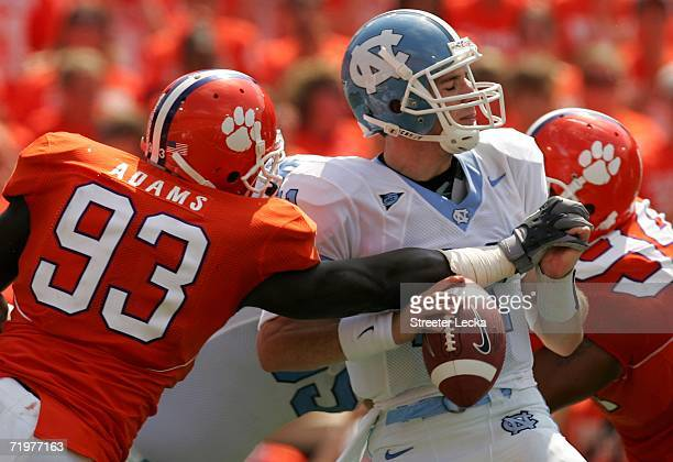 Cam Sexton of the University of North Carolina Tar Heels is sacked by Gaines Adams of the Clemson Tigers on September 23 2006 at Memorial Stadium in...