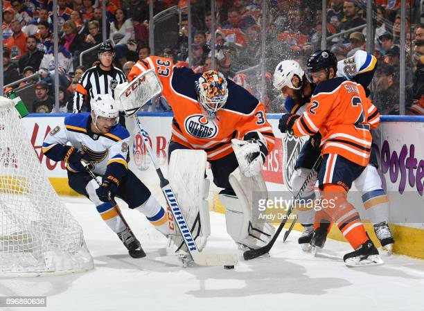 Cam Talbot and Andrej Sekera of the Edmonton Oilers battle for the puck against Scottie Upshall and Chris Thorburn of the St Louis Blues on December...