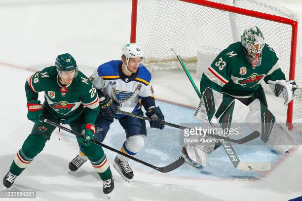 Cam Talbot and Ian Cole of the Minnesota Wild defend against Vladimir Tarasenko of the St. Louis Blues during the game at the Xcel Energy Center on...