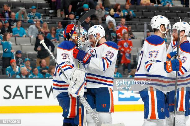 Cam Talbot and Leon Draisaitl of the Edmonton Oilers celebrate the Oilers win over the San Jose Sharks in Game Six of the Western Conference First...