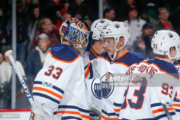 Cam Talbot and Matthew Benning of the Edmonton Oilers celebrate after defeating the Minnesota Wild at the Xcel Energy Center on December 16 2017 in...