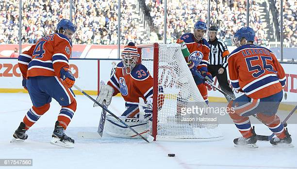 Cam Talbot Kris Russell Mark Letestu and Andrej Sekera of the Edmonton Oilers defend their net after a Winnipeg Jets shot during the 2016 Tim Hortons...