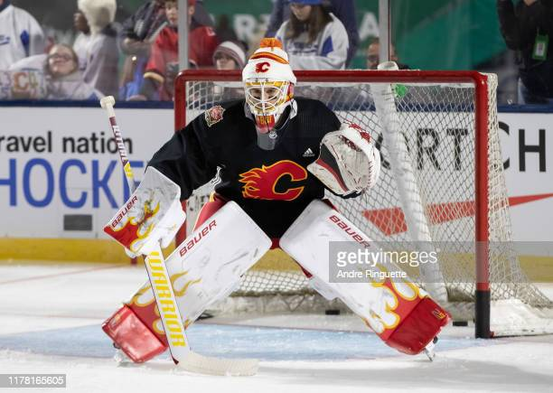 Cam Talbot of the Calgary Flames faces shots during practice in advance of the 2019 Tim Hortons NHL Heritage Classic to be played against the...