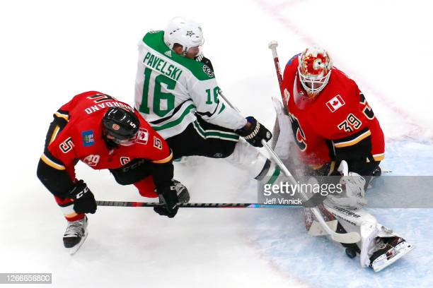 Cam Talbot of the Calgary Flames makes a kick save against Joe Pavelski of the Dallas Stars during the third period in Game Four of the Western...