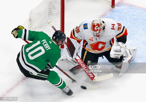 Cam Talbot of the Calgary Flames makes the first period save on Corey Perry of the Dallas Stars in Game Five of the Western Conference First Round...