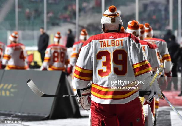 Cam Talbot of the Calgary Flames walks to the ice for warmup in advance of the 2019 Tim Hortons NHL Heritage Classic against the Winnipeg Jets at...