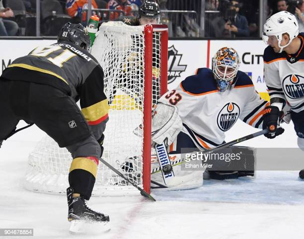 Cam Talbot of the Edmonton Oilers blocks a shot by Jonathan Marchessault of the Vegas Golden Knights as Andrej Sekera of the Oilers defends in the...
