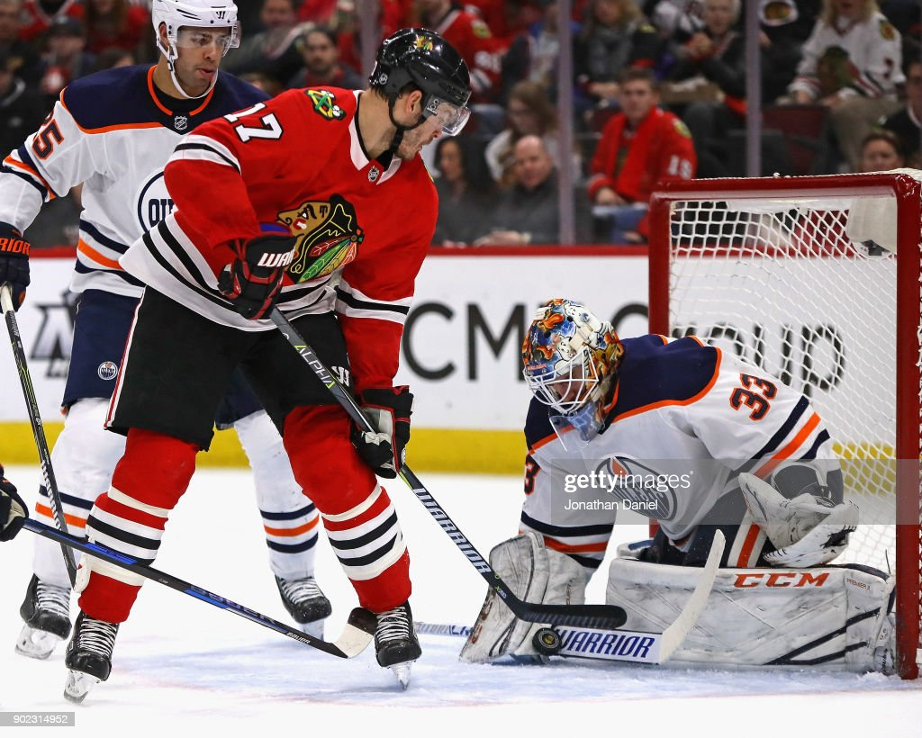 Cam Talbot #33 of the Edmonton Oilers makes a save against Lance Bouma #17 of the Chicago Blackhawks at the United Center on January 7, 2018 in Chicago, Illinois.