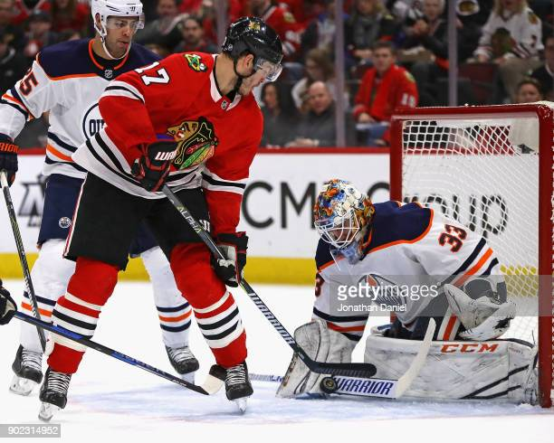 Cam Talbot of the Edmonton Oilers makes a save against Lance Bouma of the Chicago Blackhawks at the United Center on January 7 2018 in Chicago...