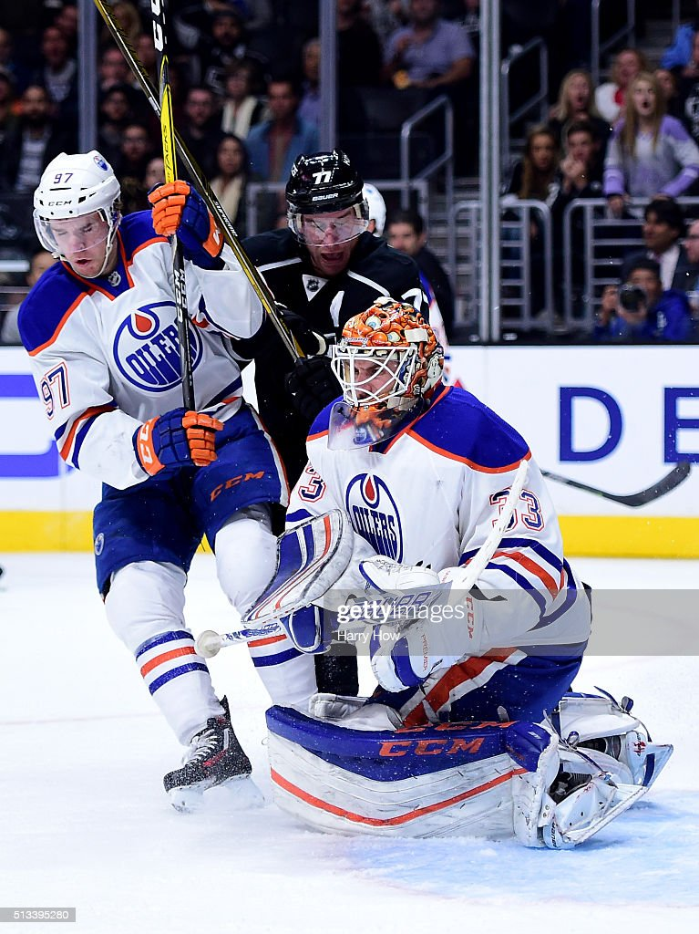 Cam Talbot #33 of the Edmonton Oilers makes a save as Jeff Carter #77 of the Los Angeles Kings and Connor McDavid #97 of the Edmonton Oilers look for a rebound during the second period at Staples Center on February 25, 2016 in Los Angeles, California.