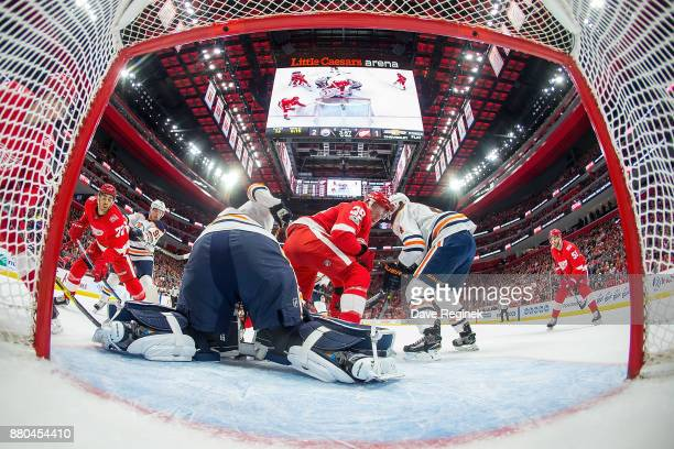 Cam Talbot of the Edmonton Oilers makes a save as teammate Kris Russell of the Oilers battles with Anthony Mantha of the Detroit Red Wings during an...