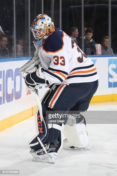 Cam Talbot of the Edmonton Oilers plays the puck against the New York Rangers at Madison Square Garden on November 11 2017 in New York City The New...