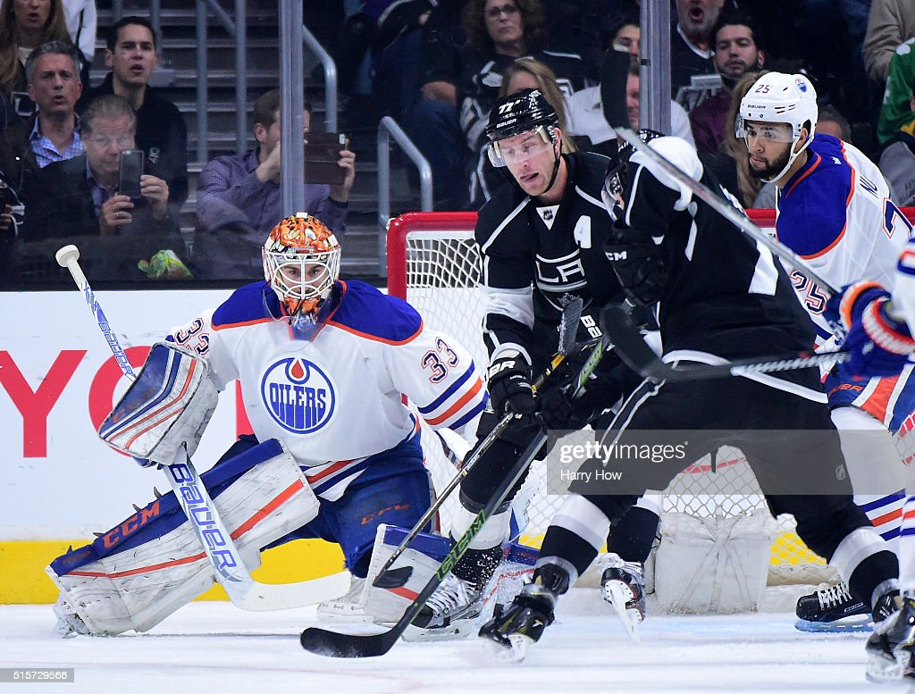 Cam Talbot #33 of the Edmonton Oilers prepares for a shot in front of Jeff Carter #77 of the Los Angeles Kings at Staples Center on February 25, 2016 in Los Angeles, California.