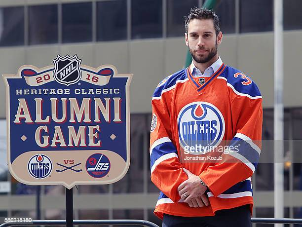 1321fbd14 Cam Talbot of the Edmonton Oilers unveils the 2016 Heritage Classic jersey  that will be worn