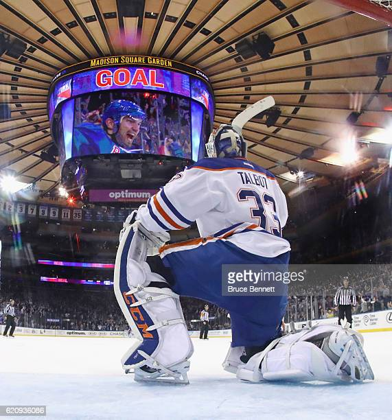 Cam Talbot of the Edmonton Oilers watches Rick Nash of the New York Rangers celebrate his game winning goal on the scoreboard during the third period...