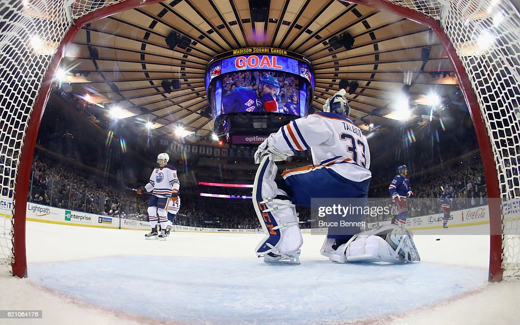 Cam Talbot #33 of the Edmonton Oilers watches Rick Nash #61 of the New York Rangers celebrate his game winning goal on the scoreboard during the third period at Madison Square Garden on November 3, 2016 in New York City. The Rangers defeated the Oilers 5-3.