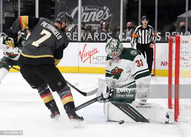 Cam Talbot of the Minnesota Wild blocks a shot by Alex Pietrangelo of the Vegas Golden Knights in overtime of their game at T-Mobile Arena on April...