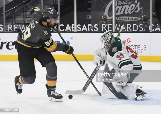 Cam Talbot of the Minnesota Wild blocks a shot by Alex Tuch of the Vegas Golden Knights in the second period of their game at T-Mobile Arena on April...