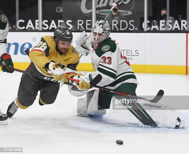 Cam Talbot of the Minnesota Wild defends the net from William Carrier of the Vegas Golden Knights in the second period of their game at T-Mobile...
