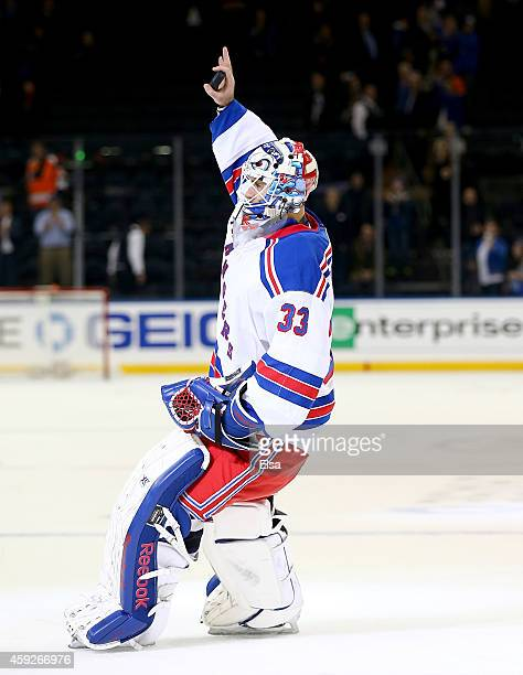 Cam Talbot of the New York Rangers celebrates after he is awarded the first star of the game against the Philadelphia Flyers on November 19 2014 at...