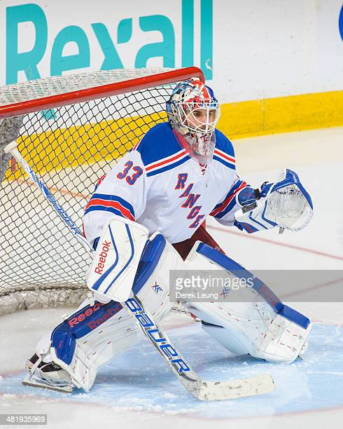 Cam Talbot of the New York Rangers in action against the Edmonton Oilers during an NHL game at Rexall Place on March 30 2014 in Edmonton Alberta...