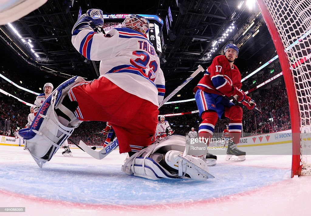 Cam Talbot #33 of the New York Rangers looks on after giving up a third period goal to Rene Bourque #17 of the Montreal Canadiens at 6:33 during Game Five of the Eastern Conference Final in the 2014 NHL Stanley Cup Playoffs at Bell Centre on May 27, 2014 in Montreal, Canada.