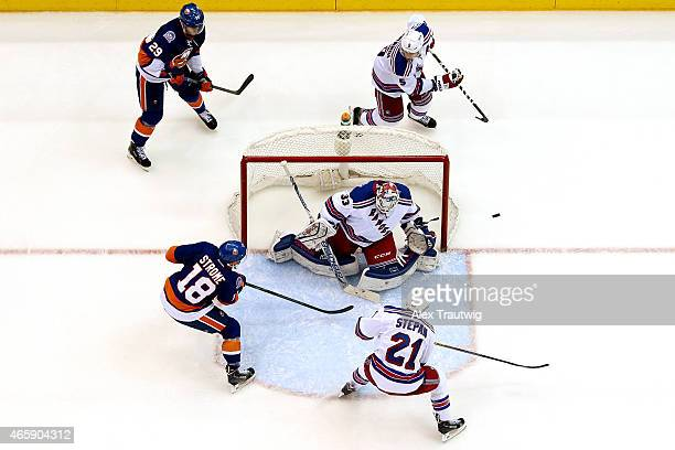 Cam Talbot of the New York Rangers makes a save against Ryan Strome of the New York Islanders during a game at the Nassau Veterans Memorial Coliseum...