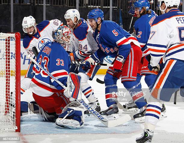 Cam Talbot of the New York Rangers makes a save against the Edmonton Oilers at Madison Square Garden on February 6 2014 in New York City