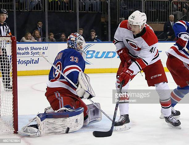 Cam Talbot of the New York Rangers makes the third period pad save on Victor Rask of the Carolina Hurricanes at Madison Square Garden on December 21...