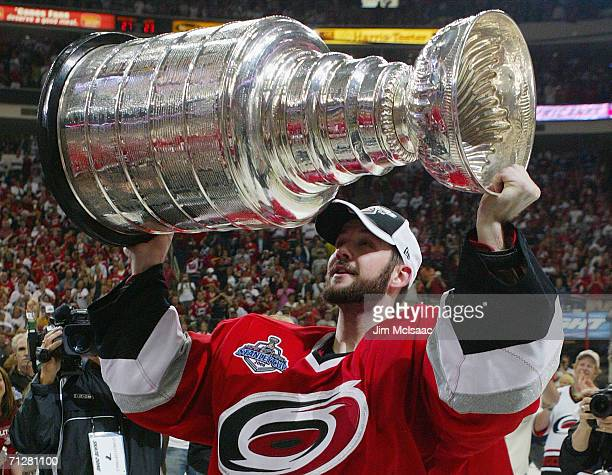 Cam Ward of the Carolina Hurricanes celebrates with the Stanley Cup after defeating the Edmonton Oilers in game seven of the 2006 NHL Stanley Cup...