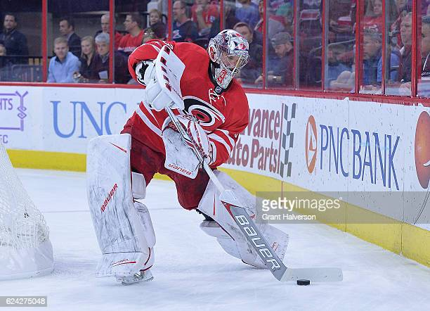 Cam Ward of the Carolina Hurricanes controls the puck against the Montreal Canadiens during the game at PNC Arena on November 18 2016 in Raleigh...