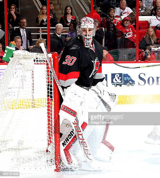 Cam Ward of the Carolina Hurricanes crouches in the crease to protect the net during their NHL game agaomst tje Columbus Blue Jackets at PNC Arena on...