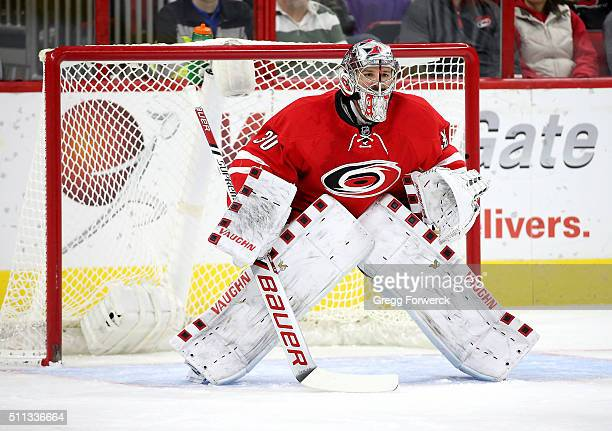 Cam Ward of the Carolina Hurricanes crouches in the crease to protect the net during an NHL game against the New York Islanders at PNC Arena on...