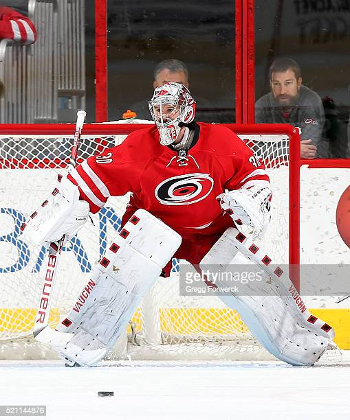 Cam Ward of the Carolina Hurricanes crouches in the crease to protect the net during an NHL game against the Montreal Canadiens at PNC Arena on April...