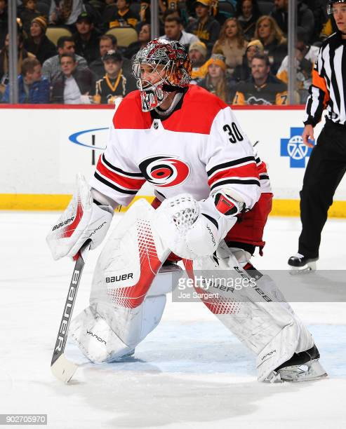 Cam Ward of the Carolina Hurricanes defends the net against the Pittsburgh Penguins at PPG Paints Arena on January 4 2018 in Pittsburgh Pennsylvania