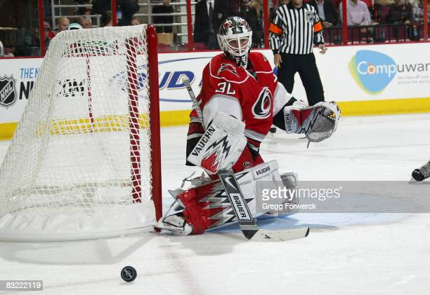 Cam Ward of the Carolina Hurricanes deflects the puck during their NHL game against the Florida Panthers on October 10, 2008 at RBC Center in...